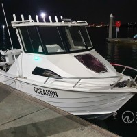 Custom built hard top with glass windows, wipers and 8 rocket launchers for a Stacer 525 Sea Runner.